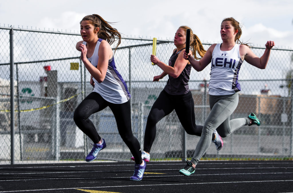 LHS track sprinters and sisters Brielle West and Caela West hand off the baton during a recent meet. Photo credit: Josh Hansen