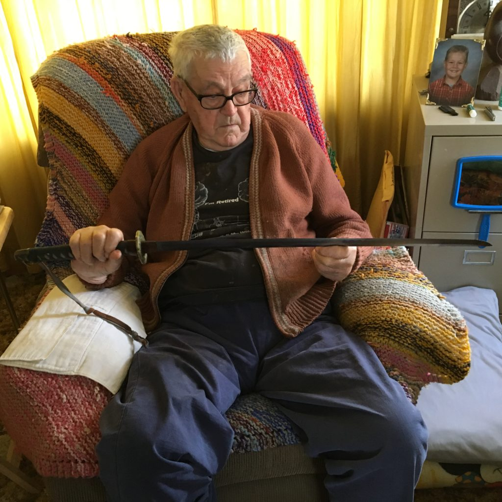 Victor Kolan holds Japanese sword.