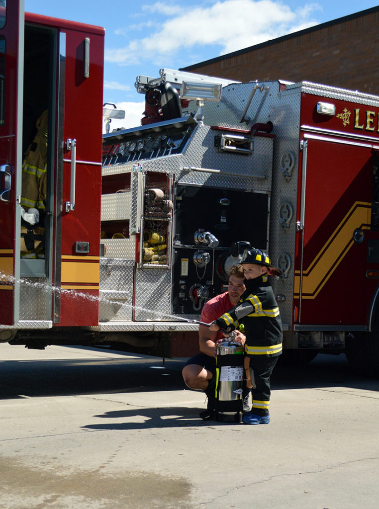 Lehi firefighter training a new recruit. Photo: Nicole Kunze