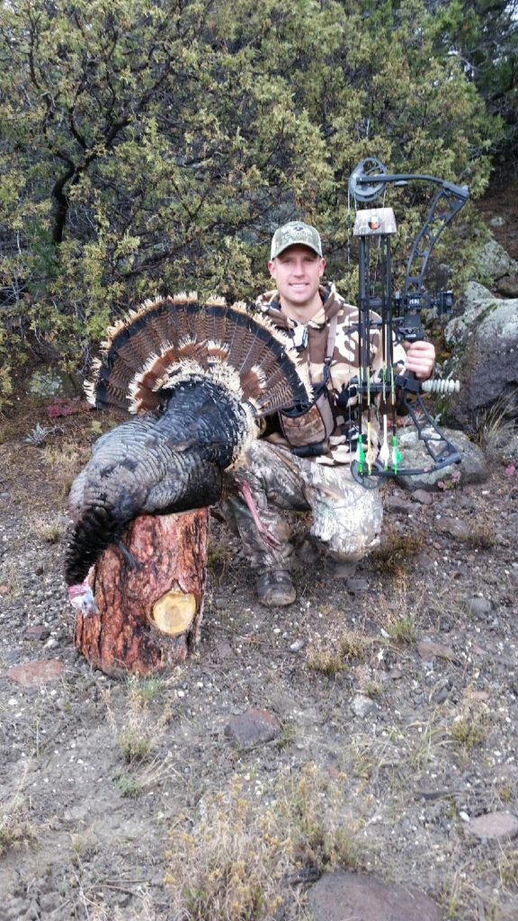 Bo Fowler proudly displays his Tom turkey.