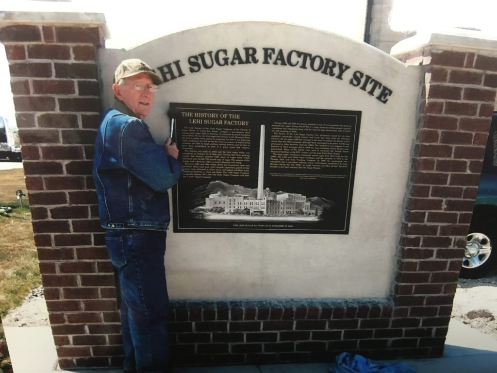 Dee Fowler placing plaque to mark Historic Lehi Sugar Factory site.
