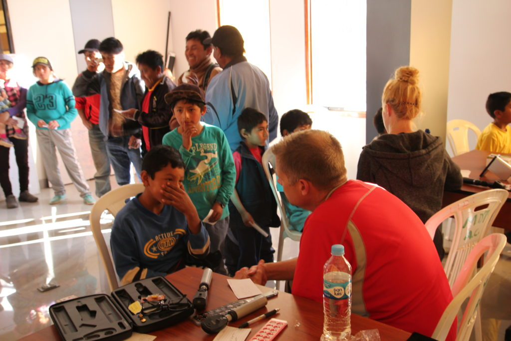 Dr. Pickering examines patients on his humanitarian mission to Peru.