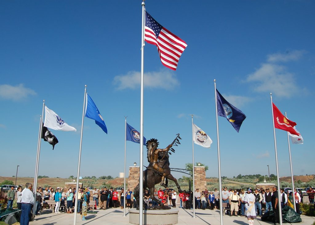 "A crowd gathers to take part in the unveiling of Lehi native and artist Jerime Hooley's 13-foot bronze statue ""Ute Warrior Chief"" during a ceremony held July 2, 2016. Photo courtesy of MaKay Hooley"