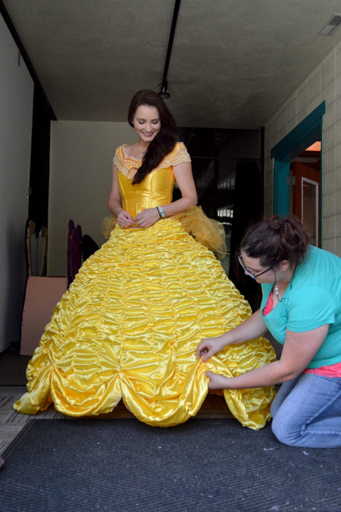 Erica Glenn getting a final fitting for Belle's ball gown with  Mariah Knittle. Photo: Nicole Kunze