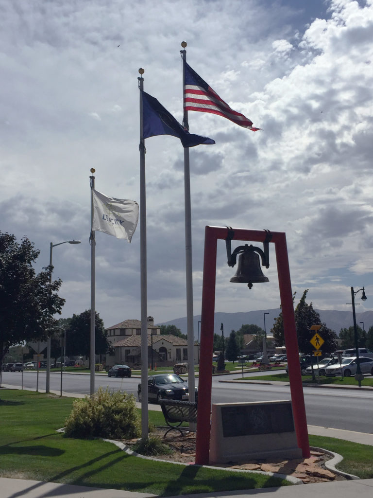 Historic fire bell and flags at LFD Station 81. Photo: Kaye Collins