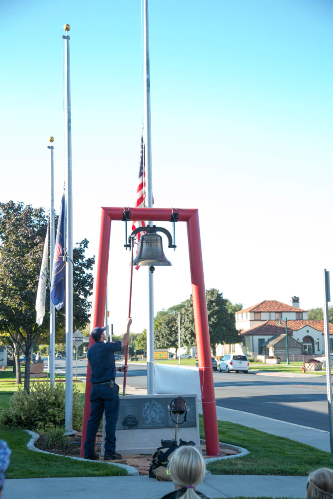 Paramedic Aaron Fuller rings the bell. Photo: Kaye Collins