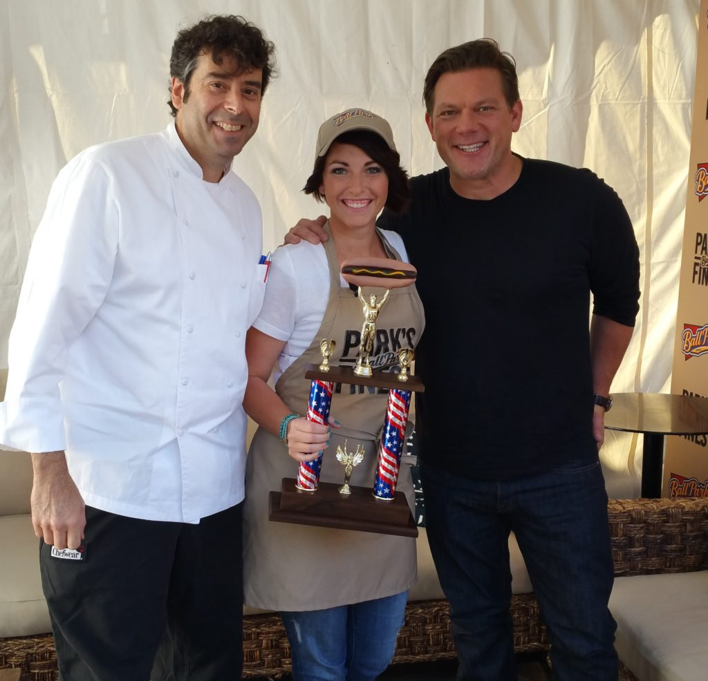 Bulloch with Food Network's Tyler Florence, holding her award trophy for longest marathon grilling team in the Guinness Book of World Records. Photo courtesy of Susie Bulloch